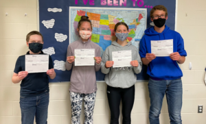 Four middle school kiddos with awards